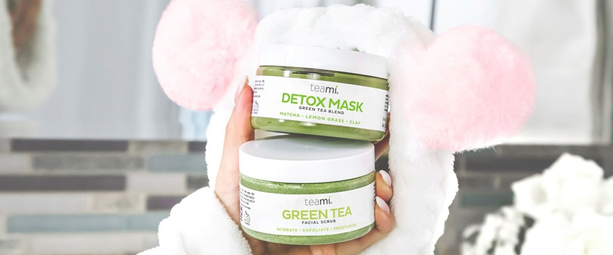 girl holding the teami blends green tea detox mask and facial scrub