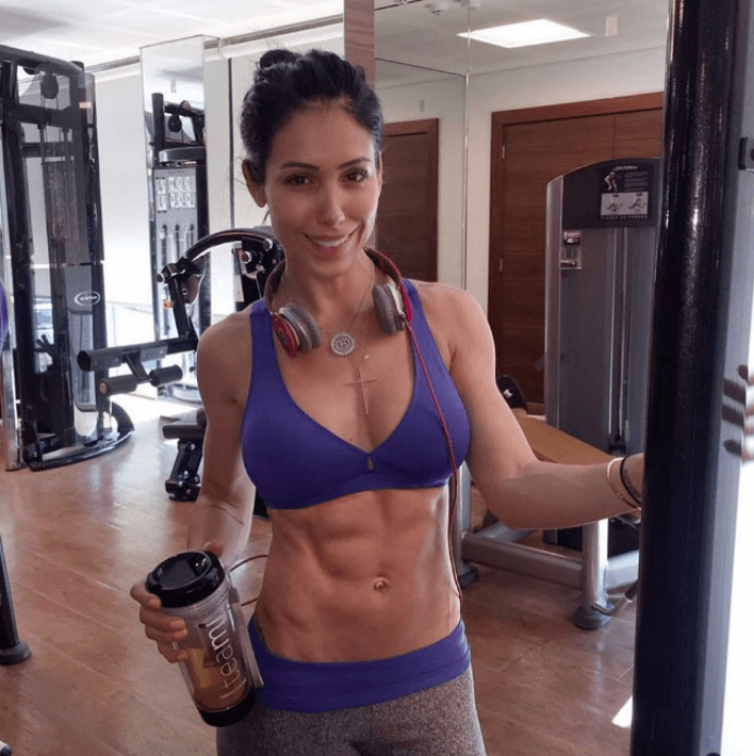 Bella Falconi at the gym with her Teami tumbler